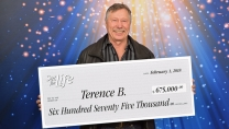 Brett Terence holding big cheque