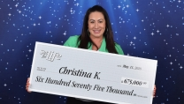 Christina Kam holding big cheque