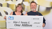 Kim and Susan Gamble holding big cheque