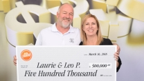 Laurie and Leo Pederson holding big cheque