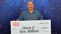 Dixon Prince holding big cheque