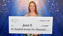 Janet R. Holding big cheque